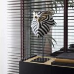 lladro owl mask in office