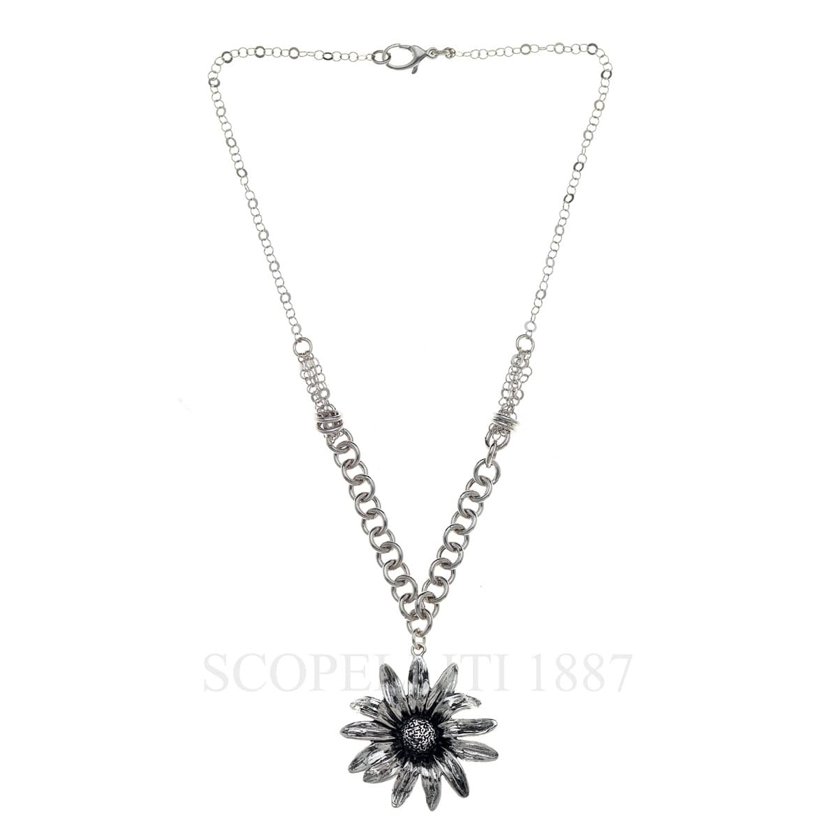 white flowers and gilded silver necklace